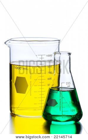 Closeup of Glass Two Beakers with Green and Yellow Liquids on a lab table with reflections. Vertical format isolated on white.