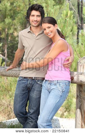 Happy couple stood in forrest