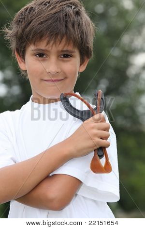 Little boy holding catapult
