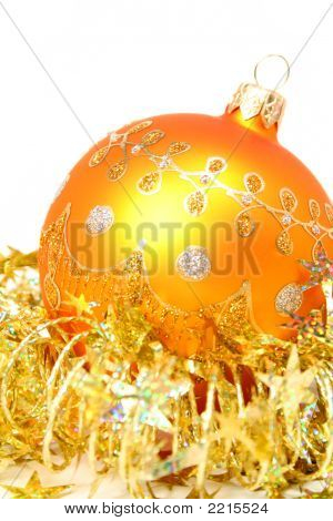 New Year's Sphere Of Orange Color And Celebratory Tinsel 3