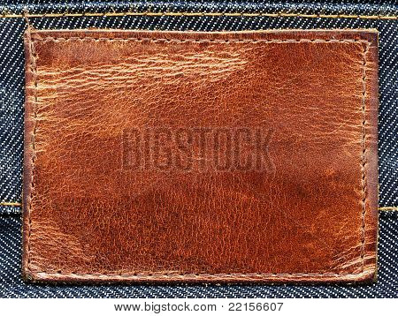 Brown leather label on blue denim