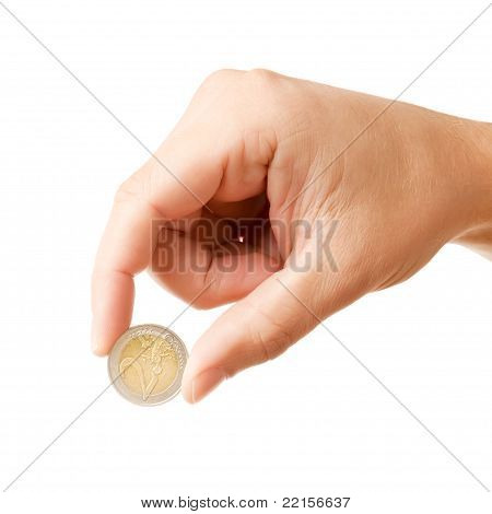 Man's hand holding 2 EURO coin