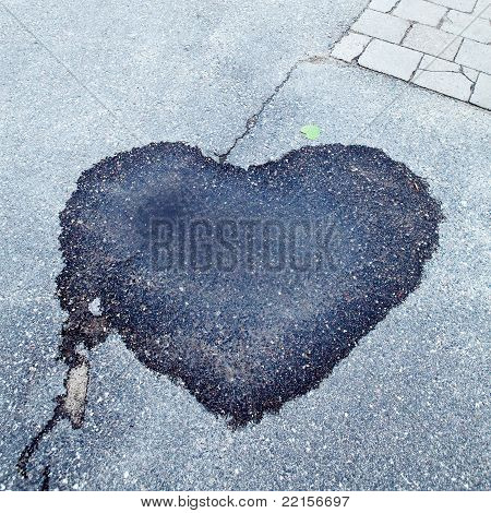 Wet dark stain in shape of heart