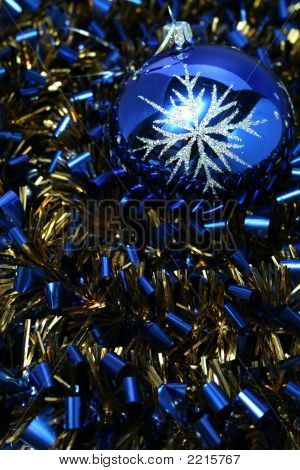 Christmas Glass Sphere On A Celebratory Tinsel