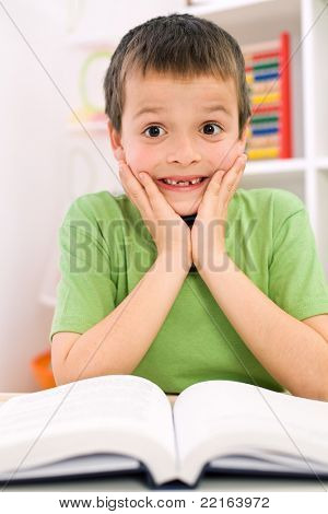 Little boy forgot reading - the stress of going back to school concept