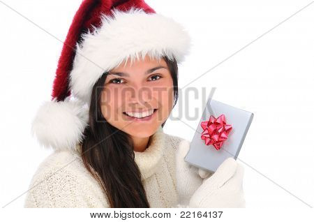 Closeup portrait of an attractive young woman wearing a Santa Claus Hat holding a small Christmas present next to her face. Horizontal format isolated on white.