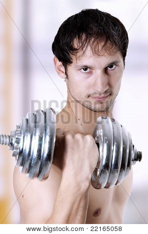Powerful Man Lifting Weights
