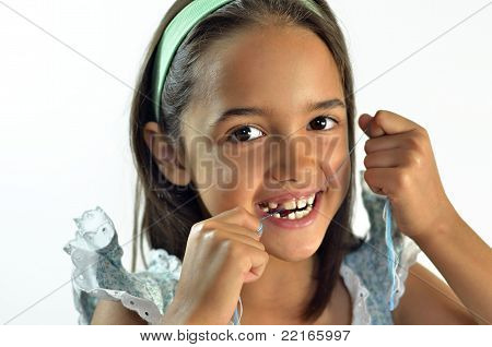 Girl Flossing Teeth