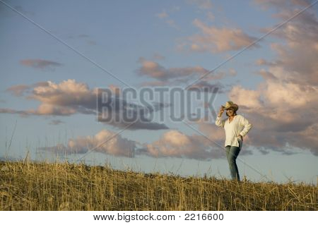 Western Woman Against A Cloudy Sky