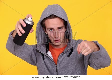 Hooded youth with paint can