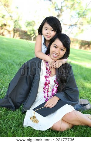 An asian mother and daughter celebrating a college graduation