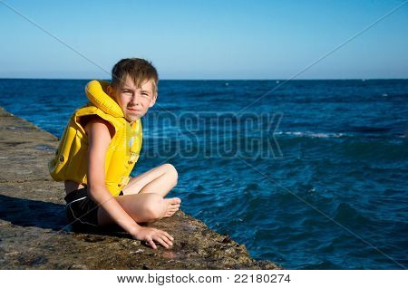 Boy In Yellow Life Jacket