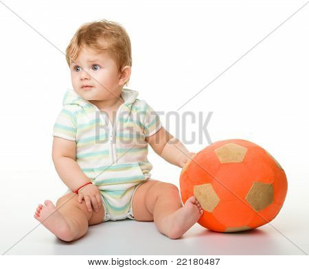 Cute Little Child Is Playing With Soccer Ball