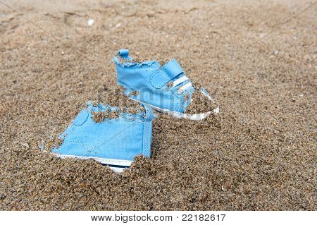 Baby Shoes On Beach