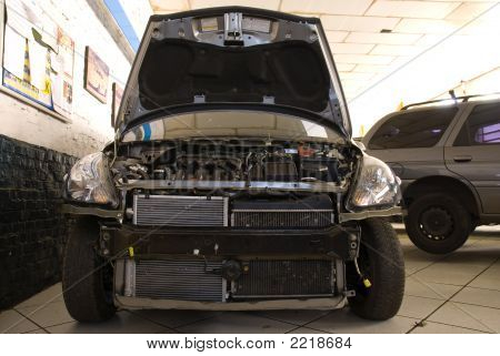 Modern Black Car In A Repair Shop