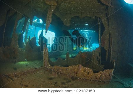 Divers Exploring A Large Shipwreck