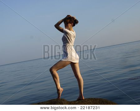 The girl in a white T-shirt on a beach