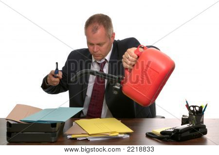 Businessman Burning Paperwork.