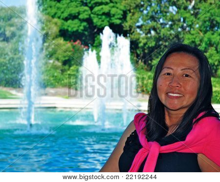 Asian woman and fountain