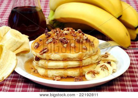 Healthy Breakfast Of Homemade Waffles, Bananas And Pecans.