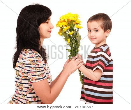 Little Boy Gives Flowers To His Mom