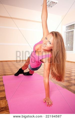 Young Woman Making Flexure Exercise In Gym