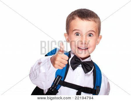 Portrait Of Elementary School Boy Showing Thumb Up
