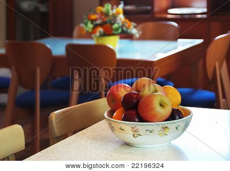 Vase Of Apples On Table In The Kitchen