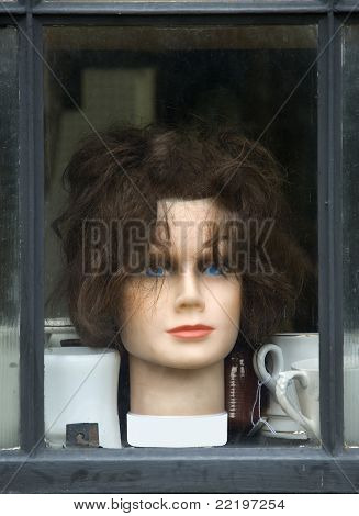display of old wig in the window