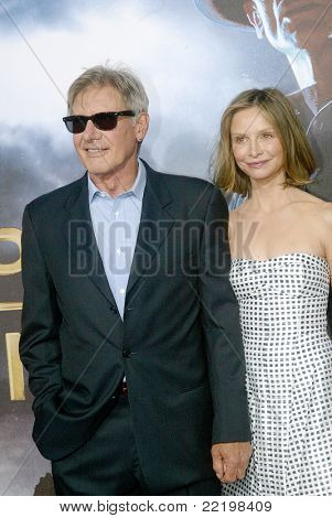 """SAN DIEGO, CA - JULY 23: Harrison Ford and Calista Flockhart arrive at the world premiere of """"Cowboys and Aliens"""" on July 23, 2011 at the Civic Theatre in San Diego, CA."""
