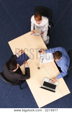 Cooperation -  Three Business People Meeting