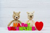 Sweet Couple Teddy Bear Doll In Love With Love Text And Red Knitting Heart On White Wooden Backgroun poster