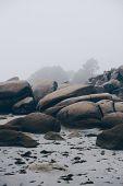 Coastal rocks and cloudy sky on the seashore peninsula O Grove, Galicia, Northen Spain. Coastline la poster