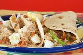 foto of chipotle  - Chicken breast fried in smoky flavor of chipotle spices and wrapped in flour tortilla with rice peppers egg vegetables onions carrot and special chipotle spread - JPG