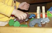 Child Playing With Wooden Toys poster