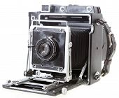 foto of workhorses  - A fully working 4x5 American press camera probably c.1958 with a 1920s lens isolated on white. This was the workhorse for a generation of US pressmen.