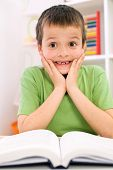stock photo of dyslexia  - Little boy forgot reading  - JPG