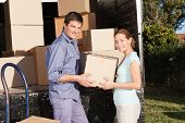 picture of moving van  - Smiling couple moving luggage at their new house - JPG