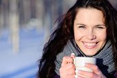 picture of beautiful brunette woman  - Smiling woman with cup of coffee in the winter park - JPG