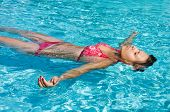 Young Girl Is Swimming