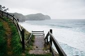 Beautiful seascape with a footpath for hiking in overcast weather. Aerial view of the Atlantic ocean poster