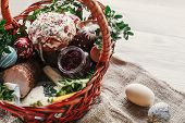 Stylish Easter Basket With Food. Horseradish, Beetroot, Ham, Butter, Buxus, Sausage And Painted Eggs poster