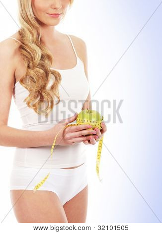 Junge attraktive sportliche Frau isolated over white background