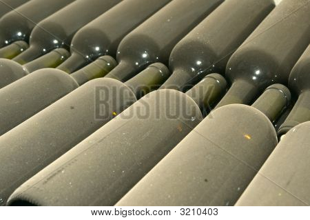 Vintage Wine Bottles In Row