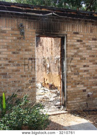 Fire Damaged Home At Doorway