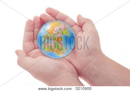 Child's Hands Holding Jigsaw Puzzle Globe