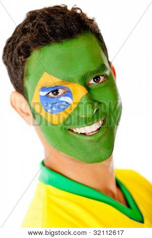 Man with flag of Brazil painted on his face - isolated over a white background
