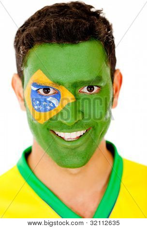 Brazilian man with flag painted on his face - isolated over a white background