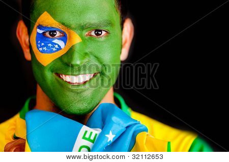 Brazilian man smiling - isolated over a black background