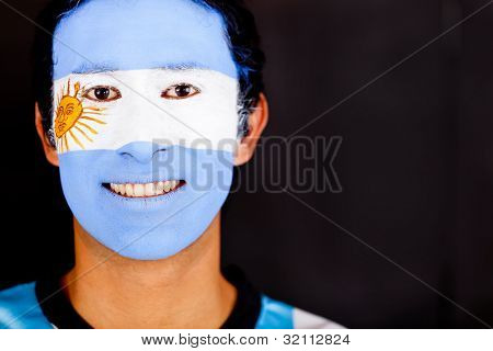 Argentinean man smiling - isolated over a black background